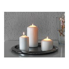 IKEA - GLÄDJANDE, Candle dish, The candle dish stands evenly because it has soft plastic feet.