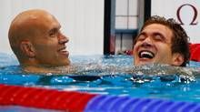 Nathan Adrian (R) of the U.S. celebrates winning the men's 100m freestyle final with Canada's Brent Hayden, who won bronze, during the London 2012 Olympic Games at the Aquatics Centre August 1, 2012. (DAVID GRAY/REUTERS)