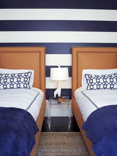 Indigo + Copper - When we say copper, we don't mean the metal. In this designer bedroom, a copper-orange upholstered headboard and bed frame make an eye-catching debut among an otherwise white and indigo color palette. The hues complement each other and allow the white to create balance with contrast. Photo courtesy of Massucco Warner Miller Interior Design