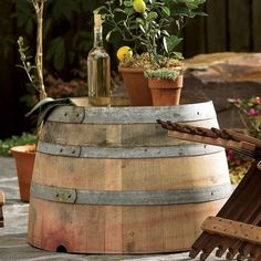 Reclaimed oak wine barrel outdoor table handmade by a local artisan for Viva Terra. Weather proof and made in the USA.