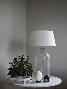 Lamp on bottle shaped glass foot, comes with a white textile shade and gold cord with switch. Farrow Ball, Glass Bottles, Your Space, Lamp Light, Interior And Exterior, Sweet Home, Lights, Modern, Inspiration