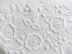 I once had a chorister's capelet, and these were some of the flowers that were on it. whitework embroidery