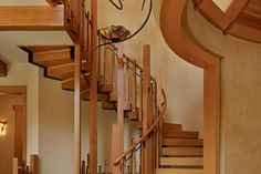 Unique curving cedar staircase. Discovered on www.Porch.com