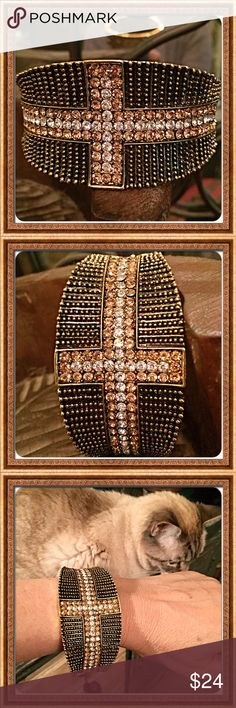 """30% OFF BUNDLES! Pave Crystal Hinged Bracelet This is a beautiful high quality & well made hinged bracelet that's got a cross row of light topaz & clear colored pave crystals set in antiqued brass. It really pops and looks great with so many different outfits. The width is 1.5"""" at widest point and fits a small to a larger wrist. NWOT Never worn except to try on and model for pics. One of our kitties loves to """"help"""" but rest assured, all my items are free of any pet hairs.Bundle this with…"""