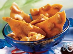 Cashew Brittle - I made this like See's Candies Cashew Brittle. I added 1 tsp butter flavoring, and brought it only to a soft crack 280, then dipped it in white chocolate. Devine!