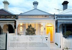 Where Victorian and contemporary meet. The front is a single story, recessed porch with over hang, and lace work between the porch posts. The rear is a two story contemporary living space with garden/patio area in between,