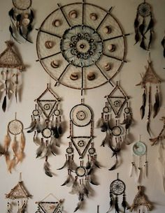From time to time I always like to test my skills and create something new and unique. Combination of wood, seashells, wood beads, natural feathers and leather. After approx 50-60 hours of work the result speaks to itself All my dream catchers are made with a lot of love and are filled