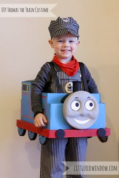 Super adorable DIY Thomas the Train Halloween Costume made from a cardboard box! from Little Red Window. My youngest grandson LOVES and breathes Thomas the Train. He would LOVE this costume, for sure! Halloween Kostüm, Holidays Halloween, Halloween Costumes For Kids, Halloween Parties, Thomas The Train Costume, Thomas Costume, Diy Cardboard, Cardboard Train, Cute Costumes
