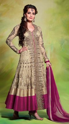Everyone is a star in their own sense, reveal the true star within you with this attractive Dia Mirza in this Beautiful cream jacquard and super net bollywood anarkali suit which is adorned with moti, stone, resham embroidery work all over and contrast dark magenta color on the broad border part. Matching bottom and dupatta attached with this attire.This Salwar Kameez can be stitched in the maximum bust size of 42 inches.