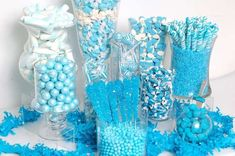 Sweet set-up by @catchmyparty! Just coordinate blue and white candies like rock candy sticks, gumballs and Sixlets® into clear containers for a beautiful candy buffet!