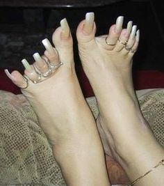 Ghettoes you can't even wear shoes with those.....wonder how much in Food stamps she gets?  Just ignorant!