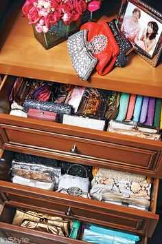 Eva Longoria keeps her clutches and jewelry stacked away neatly in a drawer in her closet.