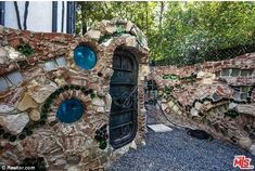 Quirky: Porthole windows and doors salvaged from vintage submarines make a unique finish