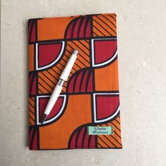 Handmade by refugees in Malawi // Orange Geo African Print Journal