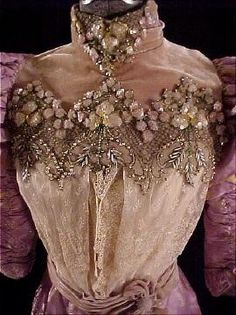 circa 1893 Lavender, Silver and Gold Silk Jacquard Brocade 2-piece Gown with Velvet, Beads, Sequins, Lace, and Pearls. (front top detail)