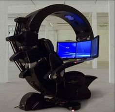 The Emperor Workstation features three LCD monitors, with a reclining chair and a slide out keyboard.