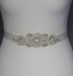 I made this beautiful bridal belt with gorgeous clear crystal rhinestones and silver seed beads , and white glass pearl . The pearl and rhinestone sash