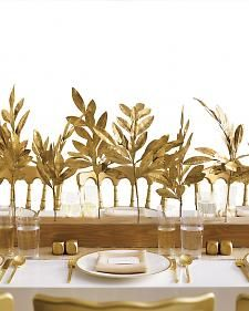 Sprayed gold leaves as a cost-saving alternative to floral arrangements
