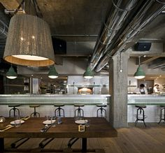 pizza east, london /  michaelis boyd.  ..wow- i really love this cold, almost factory-like space. the thought of such a mechanical, sterile environment meeting the warmth and energy that surrounds pizza is exciting. bravo-