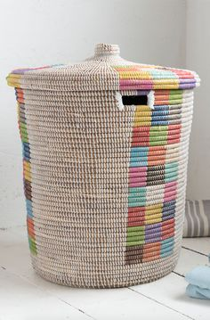 Loaf's brightly coloured and woven Disco laundry basket in this whitewashed bathroom