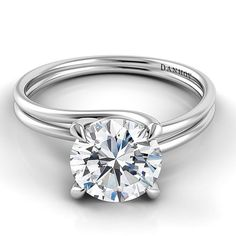 Brides.com: 64 Engagement Rings Under $5,000. Style AE135, Danhov Abbraccio Swirl Engagement Ring - 18k with .75 carat center stone, $3,550, Danhov  See more round-cut engagement rings.