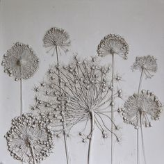 """In 2012, Rachel Dein showed the owners of a flower-shop a plaster-cast tile she had made from a bouquet. They were impressed, and soon the UK artist began receiving commissions to make more of these modern """"fossils."""" Dein's method is simple: she presses flowers into wet clay and then pours in a mixture of plaster and concrete to produce a tile. The dry tiles can be left unadorned or be painted."""