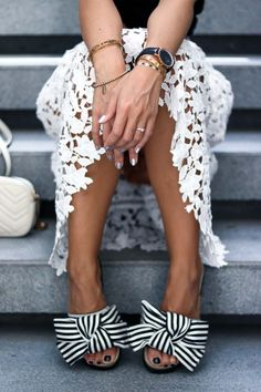 Outfit Details white lace skirt, striped slides, black and white, gold, jewelry, Essie apres-chic, silver nails, bows, summer look, Dubai, style, streetstyle, summer outfit