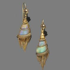 A pair of shell and gold earrings, circa 1870 Each floral surmount with half-pearl detail, to a vertically set iridescent seashell within a scrolling ropetwist frame and an articulated tassel of polished tapering links via Bonhams