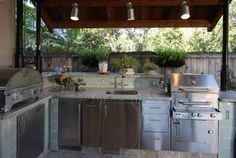 Love some lighting over outdoor kitchen, especially the grill