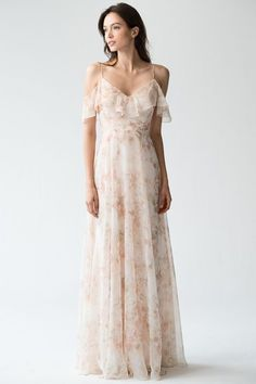 A soft floral off-the-shoulder bridesmaid dress is exactly what your spring wedding needs. Bonus: you will totally wear this again, because #stunner. Jenny Yoo Mila Dress from Brideside. #sponsored