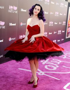 Katy Perry twirls in a red dress and perfectly sums up her sense of style: sultry yet whimsical.