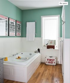 what a great bathroom...love the color and the prints on the wall