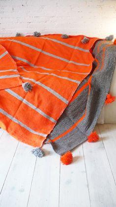 Image of Moroccan POM POM Blanket - Grey with Orange Stripes