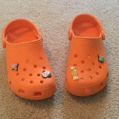3e911a576 Croc s Shoes Orange with ice cream charms on. Slight wear on bottom