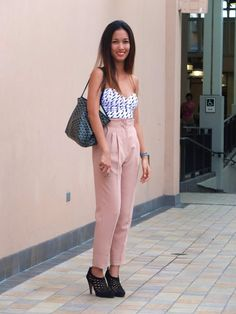 Love the look- Bustier tucked into High-waisted pastel pants with adorable booties. High-waisted pants don't look great on me so I'd tuck it into a skirt instead, and keep the rest of the look the same, so flawless!