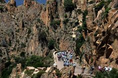 The pack rides during the 145.5-kilometer third stage of the Tour de France cycling race on July 1. The stage wound from Ajaccio to Calvi on the French island of Corsica.