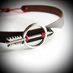 Silver Katniss - Hunger Games leather bracelet with red linen.  From JewelryByMaeBee on Etsy. $24
