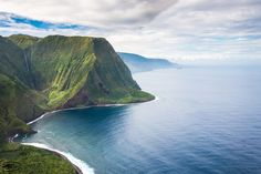 Jurassic Cliffs - The north coast of Moloka'I Island is an untouched beauty with waterfall taller than the empire state building, black sand beach, beautiful water, green forest… Only very few people live on this side of the island. The only way to admire those cliffs are by boat or helicopter. Another wonder of nature.