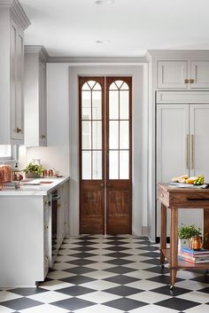 Future Home Interior Joanna Gaines walks through her favorite design tips from the kitchen of the Scrivano homefeaturing checkered floors, antique doors and gold hardware. Tudor Kitchen, New Kitchen, Kitchen Decor, Kitchen Wood, Kitchen Cabinets, Kitchen Pantry, Kitchen Ideas, Beige Kitchen, Concrete Kitchen