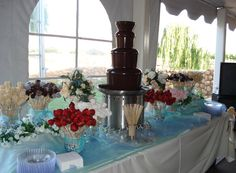 For my wedding chocolate fountain wtih Lavender flowers around for dessert Chocolate Fountain Rental, Chocolate Fondue Fountain, Chocolate Fountains, Wedding Cake Maker, Wedding Cakes, Candy Table, Candy Buffet, Wedding Reception, Our Wedding