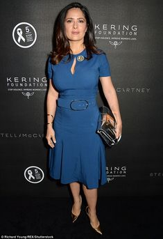 Dreamy:The  actress looked chic  in a busty blue frock as she cosied up to her husband Francois-Henri Pinault, 54 at the bash - which was organised by his company, Kering