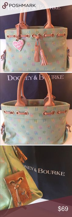 ⭐️DOONEY & BOURKE BAG 💯AUTHENTIC DOONEY & BOURKE BAG 100% AUTHENTIC. SO PRETTY AND CHARMING. A LOVELY BAG! PERFECT FOR SPRING AND SUMMER WITH A LOVELY PALE GREEN COLOR. A GREAT BAG PERFECT FOR ANY OCCASION. THIS DELIGHTFUL BAG HAS FOUR INTERIOR WALL POCKETS ! THE BAG MEASURES 10.5 INCHES WIDE BY 6.75 INCHES TALL! A GREAT HANDBAG FOR SURE! Dooney & Bourke Bags