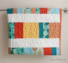 This Bright and Cheery Fat Quarter Crib Quilt is a great way to learn how to sew a baby blanket. The small dimensions of this DIY baby quilt makes the project less time consuming than a regular full-sized quilt.