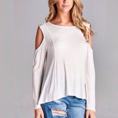 """COLD SHOULDER LIGHTWEIGHT LONG-SLEEVE TOP. Cold shoulder, lightweight, soft, long sleeve high/low top, made in the USA. 96% rayon 4% spandex. Size small; 36"""" bust 23"""" front length 27"""" back length. Medium and Large also available in our closet. No trades and a smoke free home. Thank you for stopping by @treasuresbytrac  April Spirit Tops Tees - Long Sleeve"""