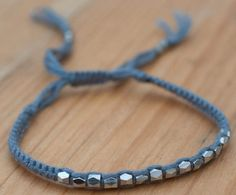 Grey thread and silver effect bracelet £9.95