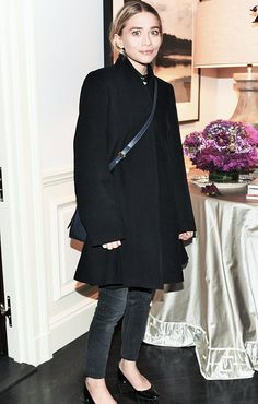 Ash with coat and bag by The Row and heels by Manolo Blahnik