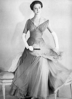 French aristocrat, socialite and fashion designer, Jacqueline, Comtesse de Ribes (born Jacqueline Bonnin de La Bonninière de Beaumont) in a Jean Dessès gown (1956)
