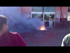 Lighting firecrackers to celebrate Lunar New Year in a Vietnamese shopping center in San Jose.