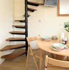 3 Small Space Solutions in 1 Tiny Kitchen Corner: lower stairs are to the back so area in front of stairs is usable; folding chairs can be out of the way when not in use; and TV is mounted high.