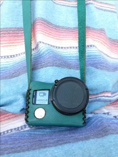The Travler - A Vintage Inspired, Hand Stitched, Leather Case designed to fit GoPro® Hero 3, and Hero 4.